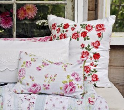 These floral pillows, although different colors, go well together because they have the same background color and similar feel.