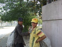 Boys who collect rubbish for a living, hoping to find something of value