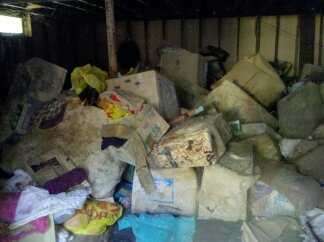 This is in the basement. All of this stuff was destroyed by a pipe burst and now there is unhealthy levels of mold and mildew growing. The inside of the house is much worse!