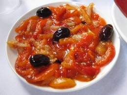 Esgarrat, a kind of salad used as a starter, involving strips of peppers and sometimes olives and salted cod.(Italian)