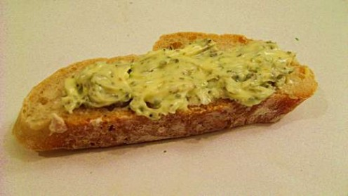 Homemade herb butter on bread / Photo by E. A. Wright