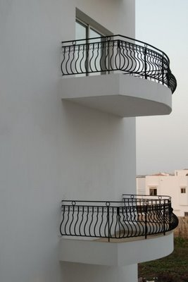 Hopefully your construction projects never turn out this bad. This is a humorous photo of a building with a balcony that is completely inaccessible--unless you jump down from the balcony above that is.