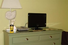 Teeny screen TV in the bedroom