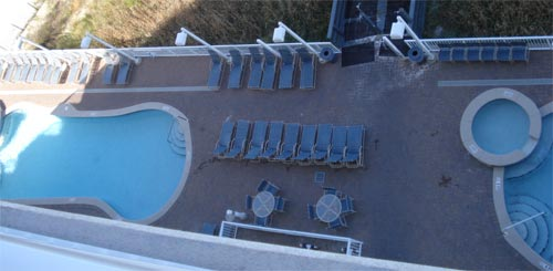 Resort included two outdoor pools and a hot tub, which could be visible by looking straight down from the balcony.