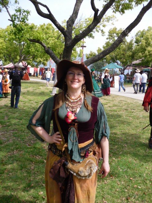 One of my favorite playtrons enjoying ren faire, and showing off her flower. Notice her bota bag full of water.
