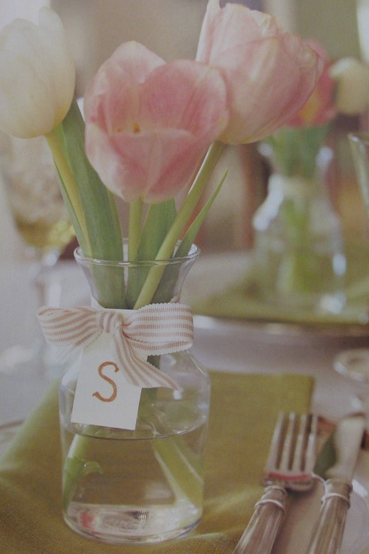 Small bud vase with tulips place setting favor.