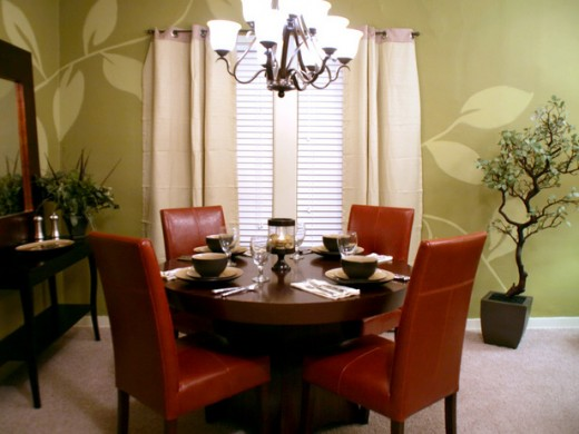 The stenciled walls in this relaxed, yet formal dining room add a nice touch and is easy and inexpensive to do.
