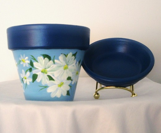 Charming hand-painted flower pot from theshoppesonsharonstreet.com