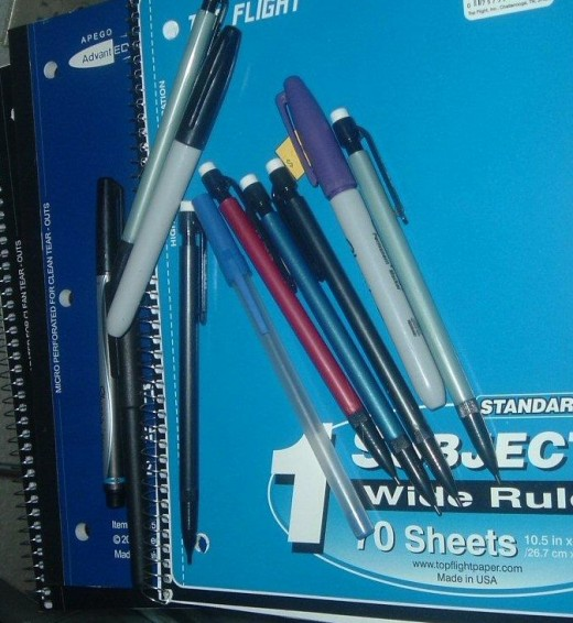 Keep a stack of notebooks and pens to encourage you to write in your journal