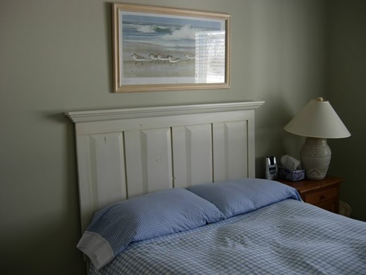 Old door as headboard with added molding.