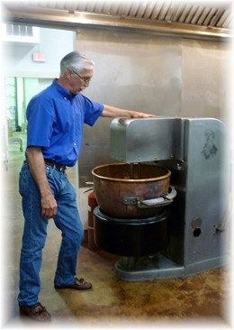 Kenneth Wilkinson explaining how sugar is melted in this large copper pot