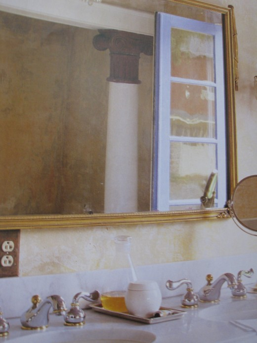 An old framed mirror can make a dramatic change to a bathroom.