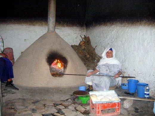 This is a different looking type of clay oven from the Indians at Taos Pueblo.  The cooking techniques and benefits are similar.