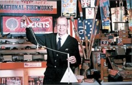 Orville Carlisle with a model rocket in back of his Norfolk, Nebraska shoe store. This place also served as his little pyrotechnic museum cum workshop.