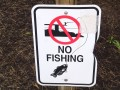 """No Fishing"" sign near pool on Solid Rock Church grounds. Photo: Greg Reese 2010 Mom&Son"