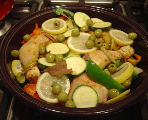 Place the browned chicken and other ingredients into the Tajine.