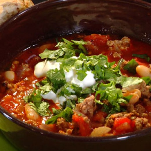 When you serve the Copycat Recipe For Disney Mom's Chili top it with sour cream and cilantro.