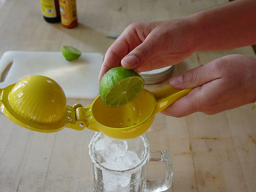 Pressing the citrus with a citrus juicer