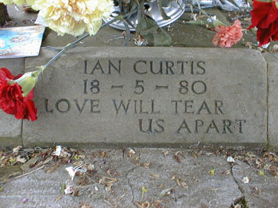 Debbie Curtis had the words ``Love Will Tear Us Apart'' inscribed on Ian's headstone.