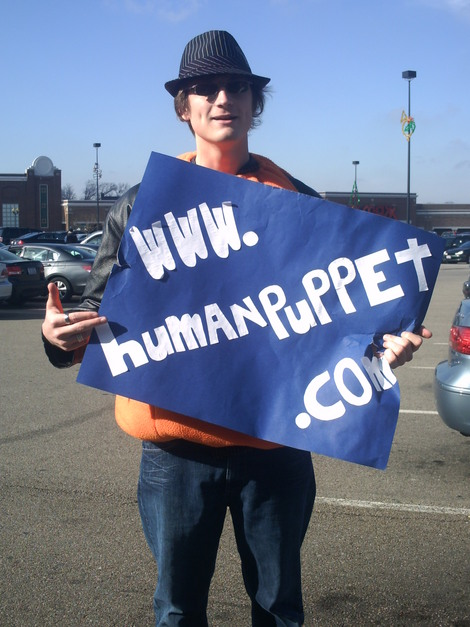 Forest Thomer, The Human Puppet, displays his sign outside the Sarah Palin Book signing in Cincinnati.