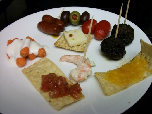 Baby carrots w/ ranch, sausage in brown sugar mustard sauce, olive skewer, tomato skewer, cocktail meatballs in balsamic soy, tortilla w/ cheddar, tortilla w/ Costco's Bruchetta, Costco Shrimp (Salad), Triscuit w/ Jalapeno Jack