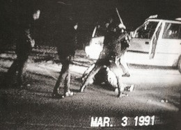 This photo take out of a video shows Rodney King on the ground being bludgeoned by some police officers for a traffic violation.
