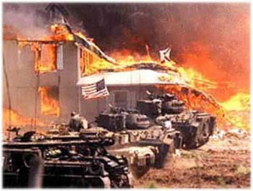 The Branch Davidian compound went up in flames after a three month siege by firearms control agents and other policing authorities. 80 people died in the flames, not being allowed escape as shots were fired into the compound while it burned. Most of