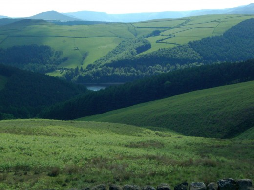 Reservoir below, hills around the Edale Valley in the distance