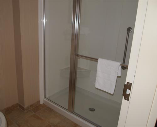 Super clean and average sized shower; not the mini-sized one most hotel rooms have.