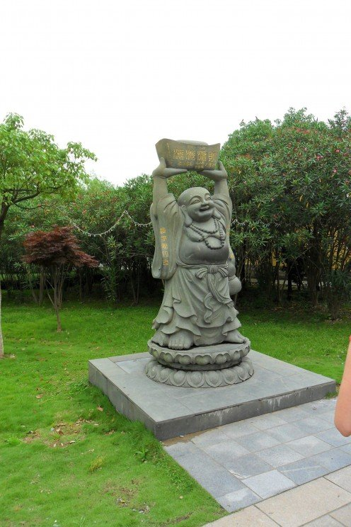 Rub the Buddha's tummy for luck