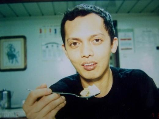 TRAVEL MAN ENJOYS EATING ASIAN FOOD
