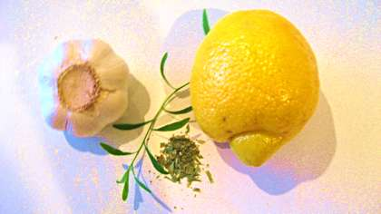 Garlic, lemon and tarragon for a homemade salad dressing / Photo by E. A. Wright