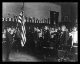 Another group of students getting ready to say the Pledge in a classroom