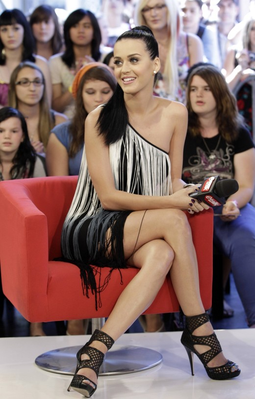 Katy Perry crosses her legs in a short dress and strappy high heels