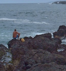 A fisherman on the Punta Brava rocks. Photo by Steve Andrews
