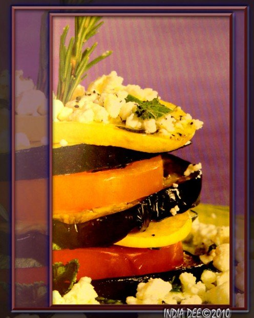 Eggplant, zucchini, squash, and tomatoes collide to stack this beautiful vegetarian Napoleon high with taste and nutrition!