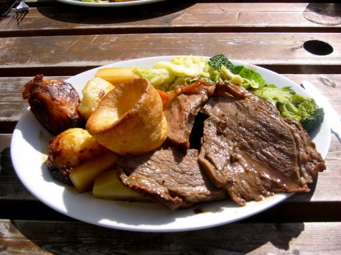 "A typical Sunday roast, the Yorkshire puddings (which are not actually puddings) are the bell shaped ""things"" (a complete descriptive blackout!)"
