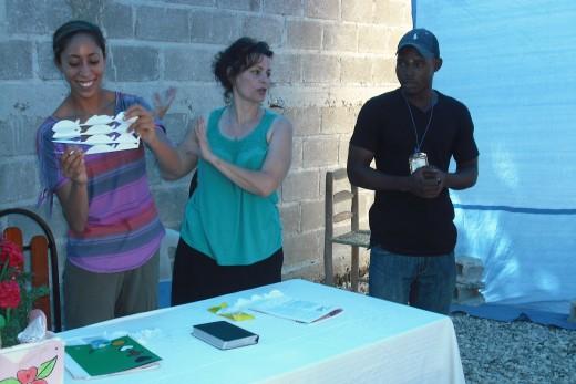 Amber and Melinda at work with interpreter, Bruno