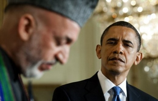President Barak Obama (right) listens as Afghanistan President Hamid Karzai speaks during a joint press conference at the White House in Washington, DC in May 2010. Karzai's government swung behind the embattled US commander in Afghanistan, warning t