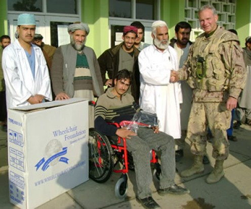 Joint Task Force Afghanistan (JTF-Afg) Deputy Commander Colonel Fred Lewis shakes the hand of a doctor at Mir Weis Hospital in Kandahar City, as the hospital accepts a donation of wheelchairs from Wheelchair Foundation Canada (WFC).