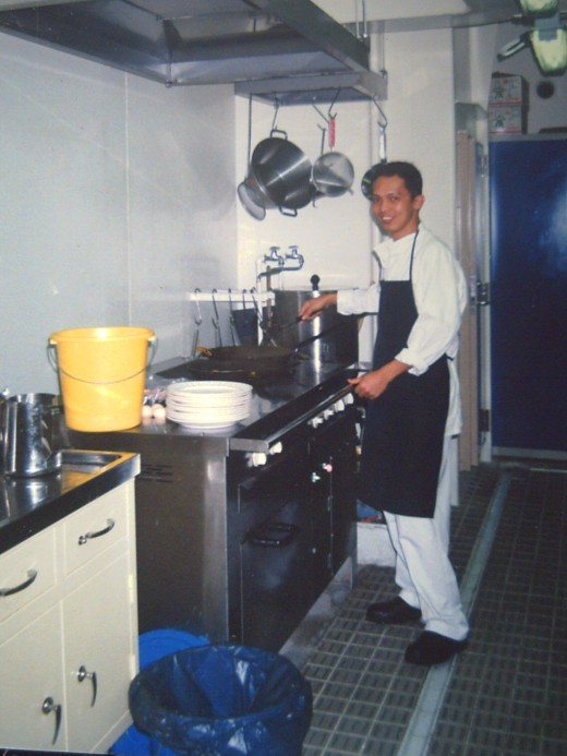 ALONE IN THE GALLEY COOKING BREAKFAST (AZTEC, 2001)