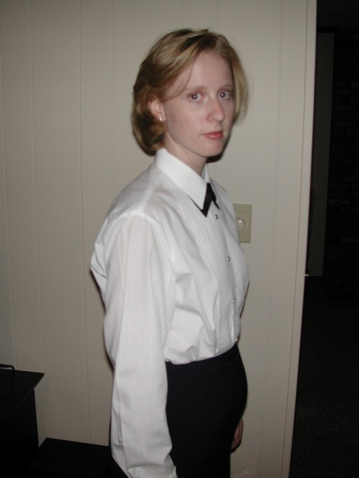 I was dressing to attend a formal graduation for the leadership school where I was teaching. I just barely fit into the skirt!
