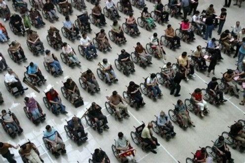 One hundred and thirty nine disabled people received wheelchairs ahead of the National Day of Disabled Persons.