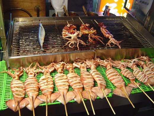grilled squid and seafoods at night market image courtesy of wikipedia
