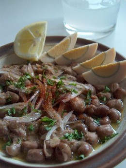 Ful Medammas -- mixture of horse beans and oil (olive) with ingredients and lime juice eaten in the morning