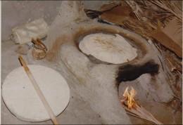 khobz -- flattened bread and is unleavened