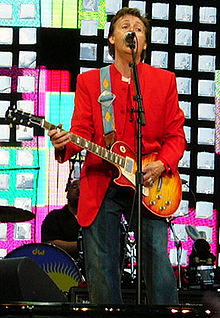 Paul Mcartney playing a left handed guitar
