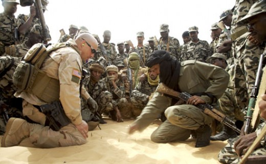A U.S. Special Forces soldier instructs Malian troops in counterterrorism tactics on the outskirts of Timbuktu. Photographs by Justin Bishop (2007).