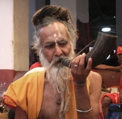 A Tantrik with a blow-horn
