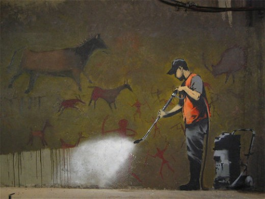 "Banksy gets ironical with his ""Council Graffiti Remover"" piece."